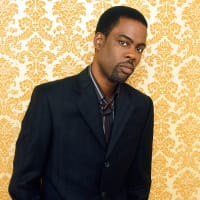 Chris Rock, head shot, yellow wallpaper