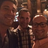 David Muir poses with Houston fans Dave Riddle and Kevin Begnaud at Armandos
