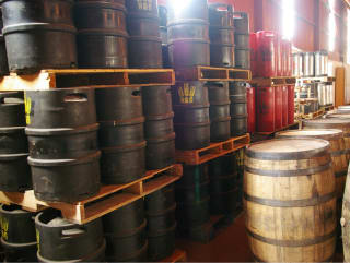 Hops and Grain brewing storage with barrels and kegs