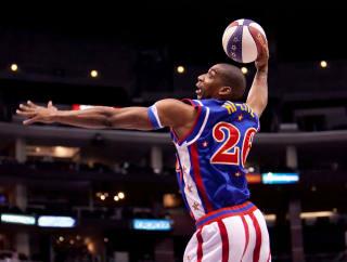Harlem Globetrotter going for a dunk