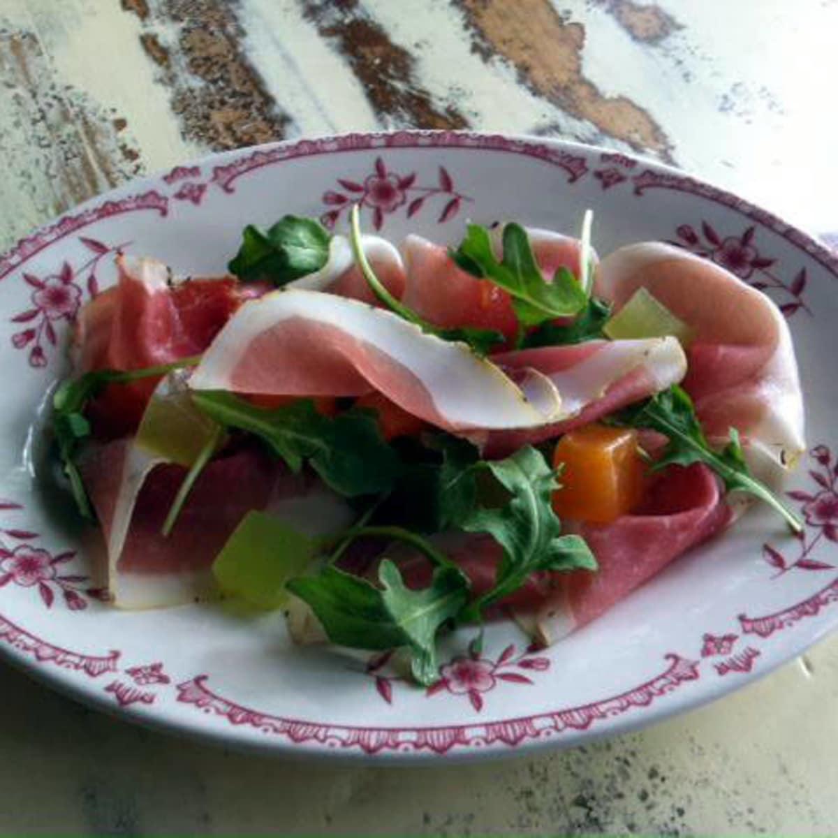Prosciutto with melon, arugula and extra virgin olive oil at Lucia restaurant in Dallas