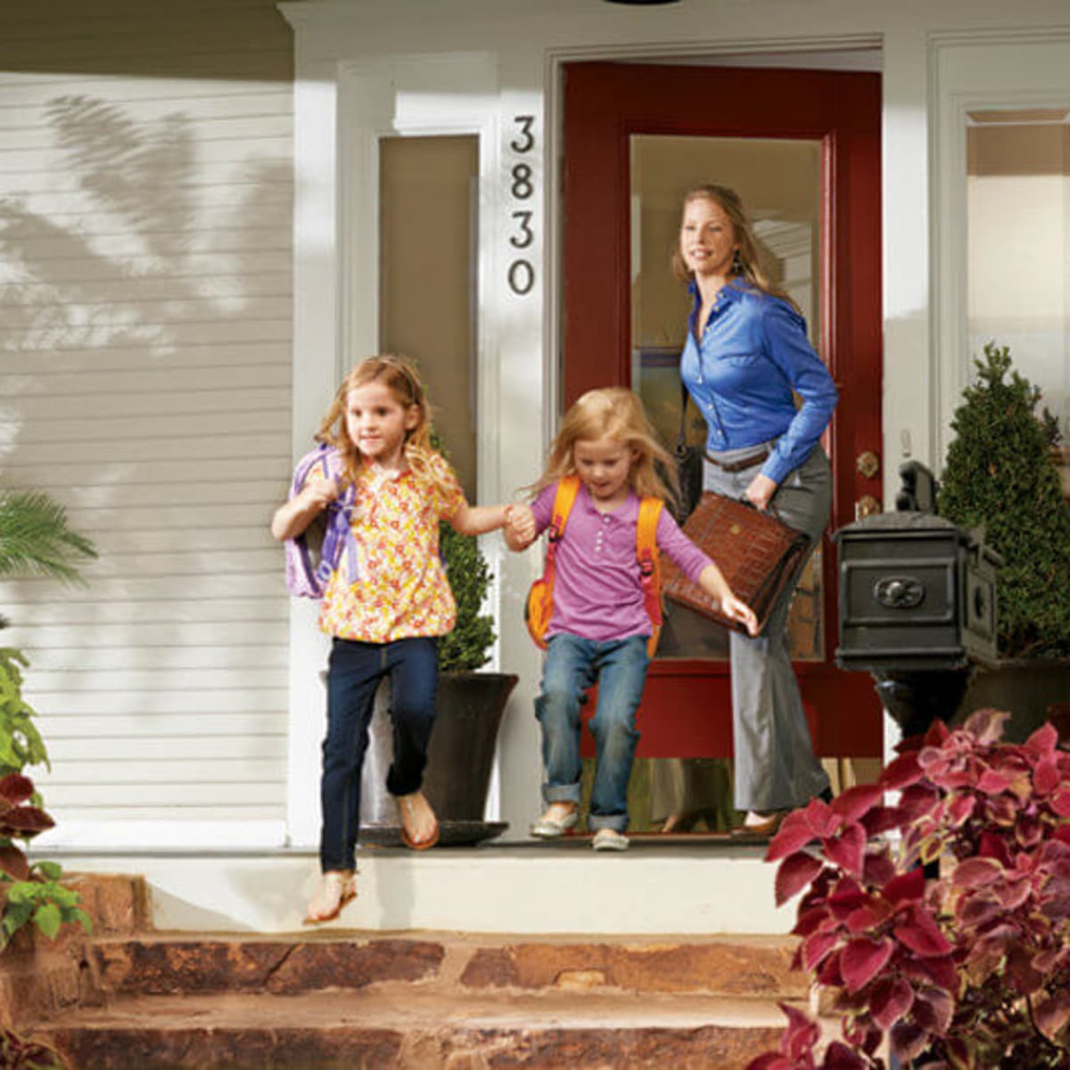 Family coming out of house