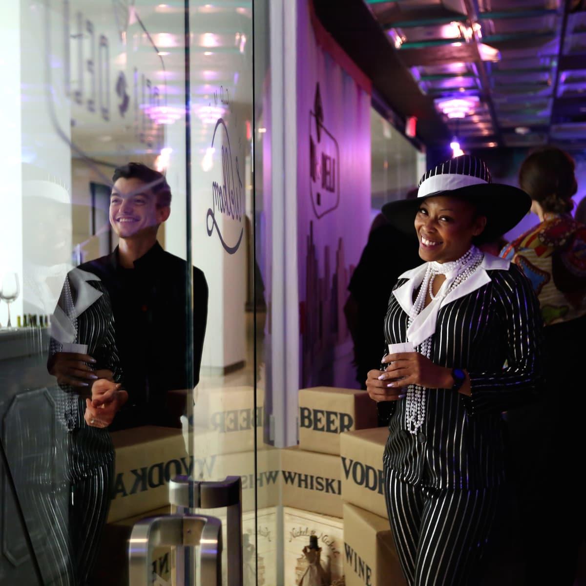 "LaToya Williams greets guests at the surprise speakeasy during the Ars Lyrica ""Roaring Twenties"" Gala"