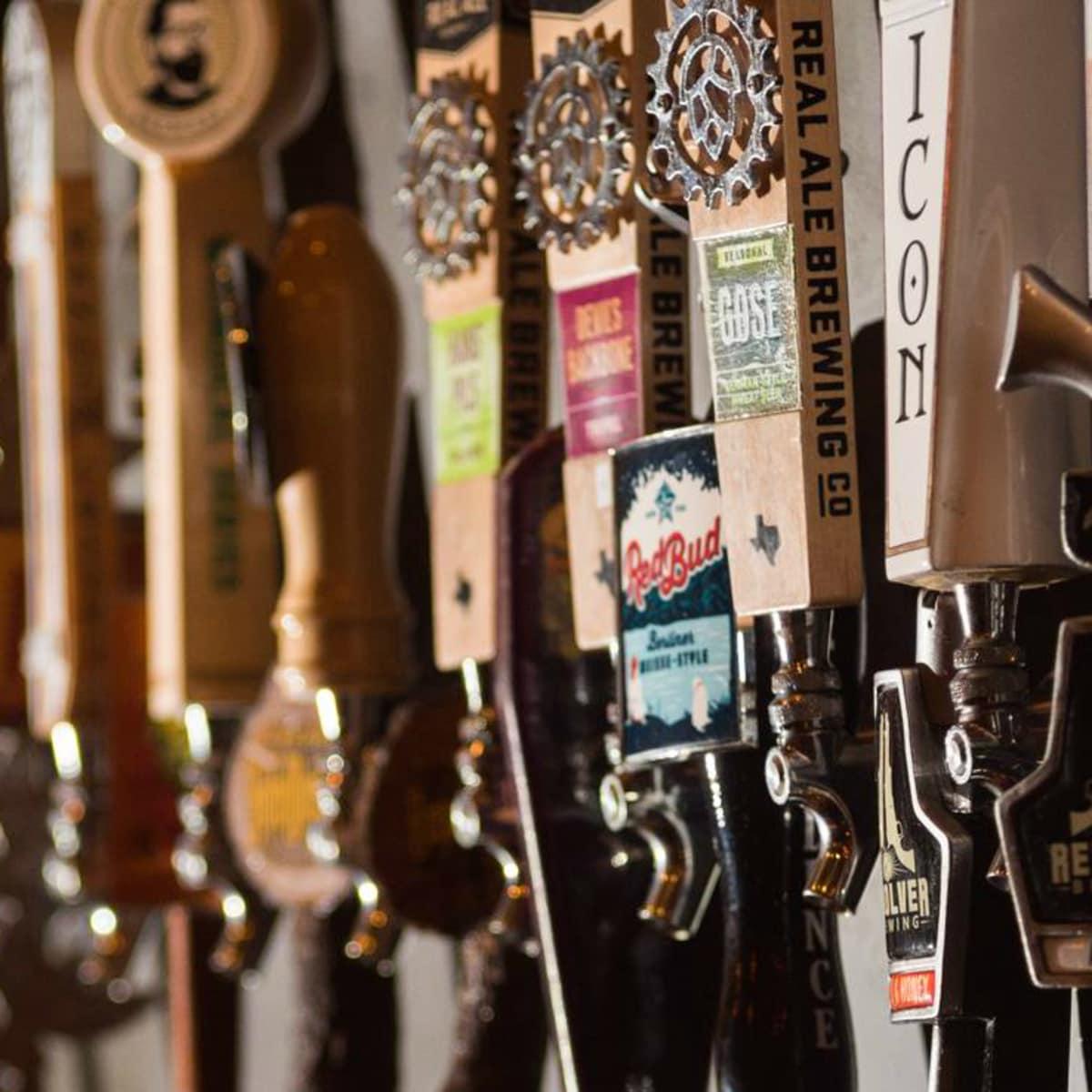 Craft Pride Austin bar Rainey Street beer tap wall