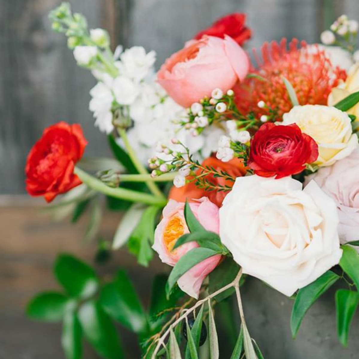 Gypsy Floral and Events red flower arrangement