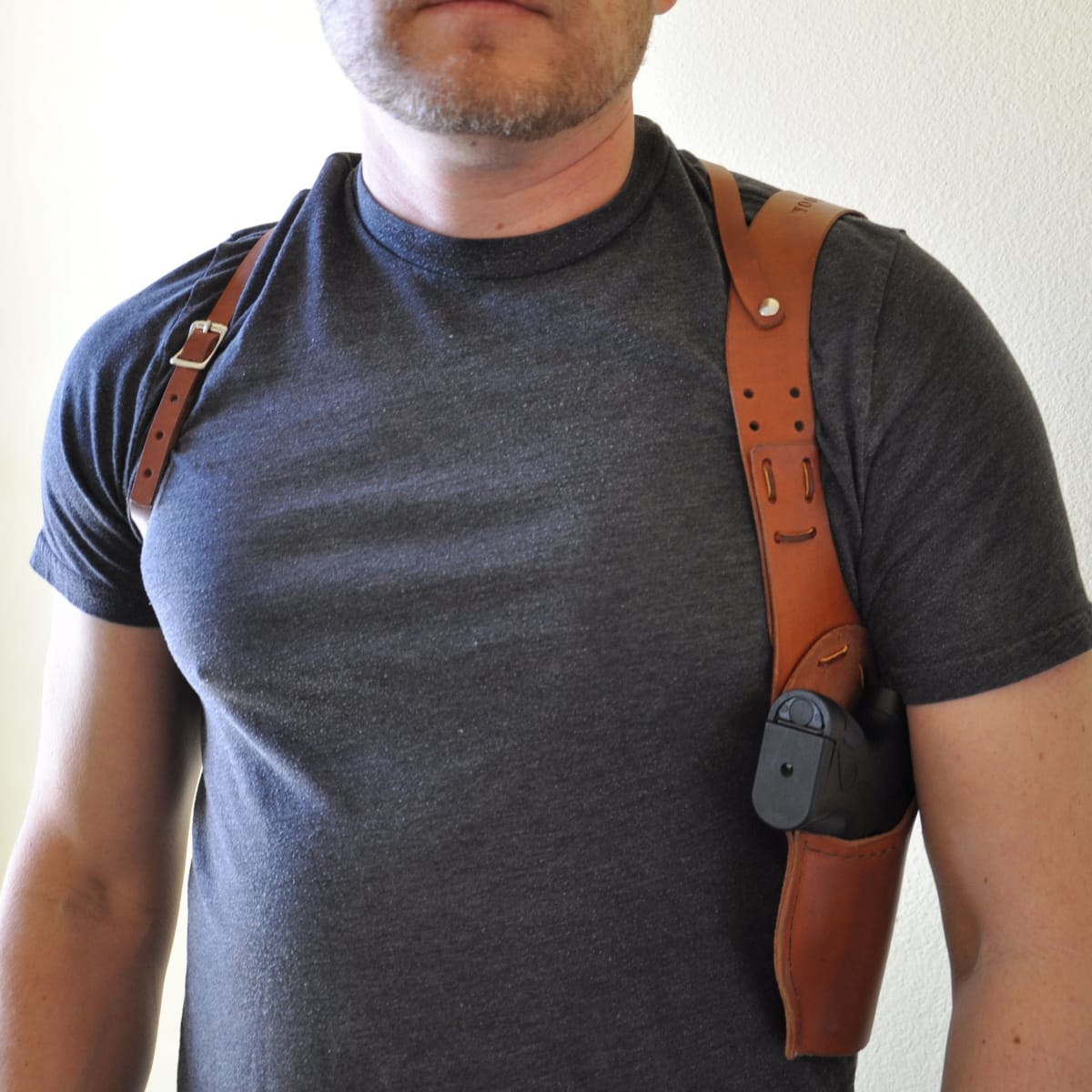 Man with pistol in shoulder holster