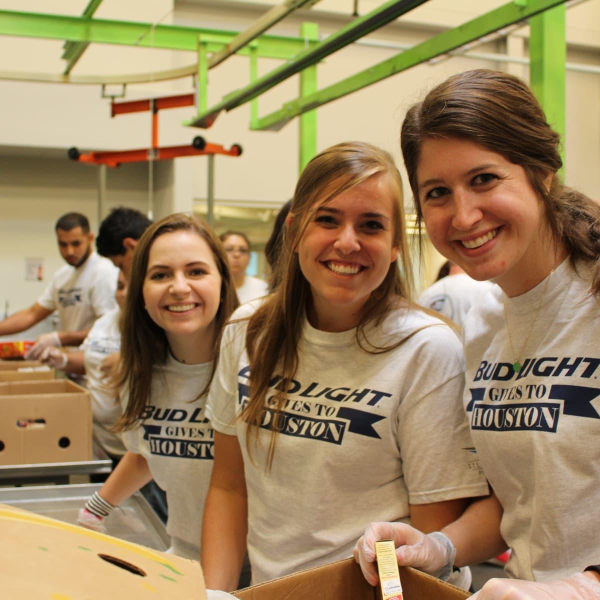 News, Shelby, Silver Eagle Distributors at Food Bank, July 2015 , Kara Neumann, Abbey Diller, Brittany London