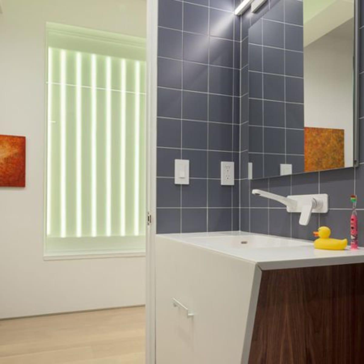Houzz bathroom with wood vanity