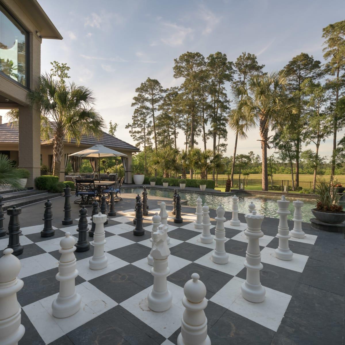 Woodlands three-story closet 47 Grand Circle exterior  chess pieces