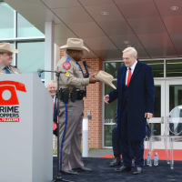 Dave Ward gets Texas State Trooper hat at dedication of Crime Stoppers new building
