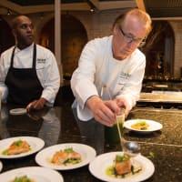 Robert Del Grande in kitchen at Recipe for Success dinner