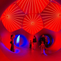 family and kids in Architects of Air luminarium at the Long Center