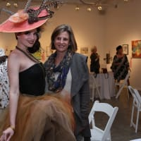 Art on the Avenue Model Stephanie Long shows off Violet Peacock's design while posing with Dianne Webb