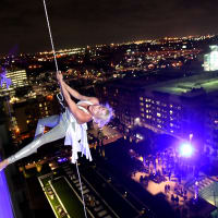 woman aerial performer side of wall