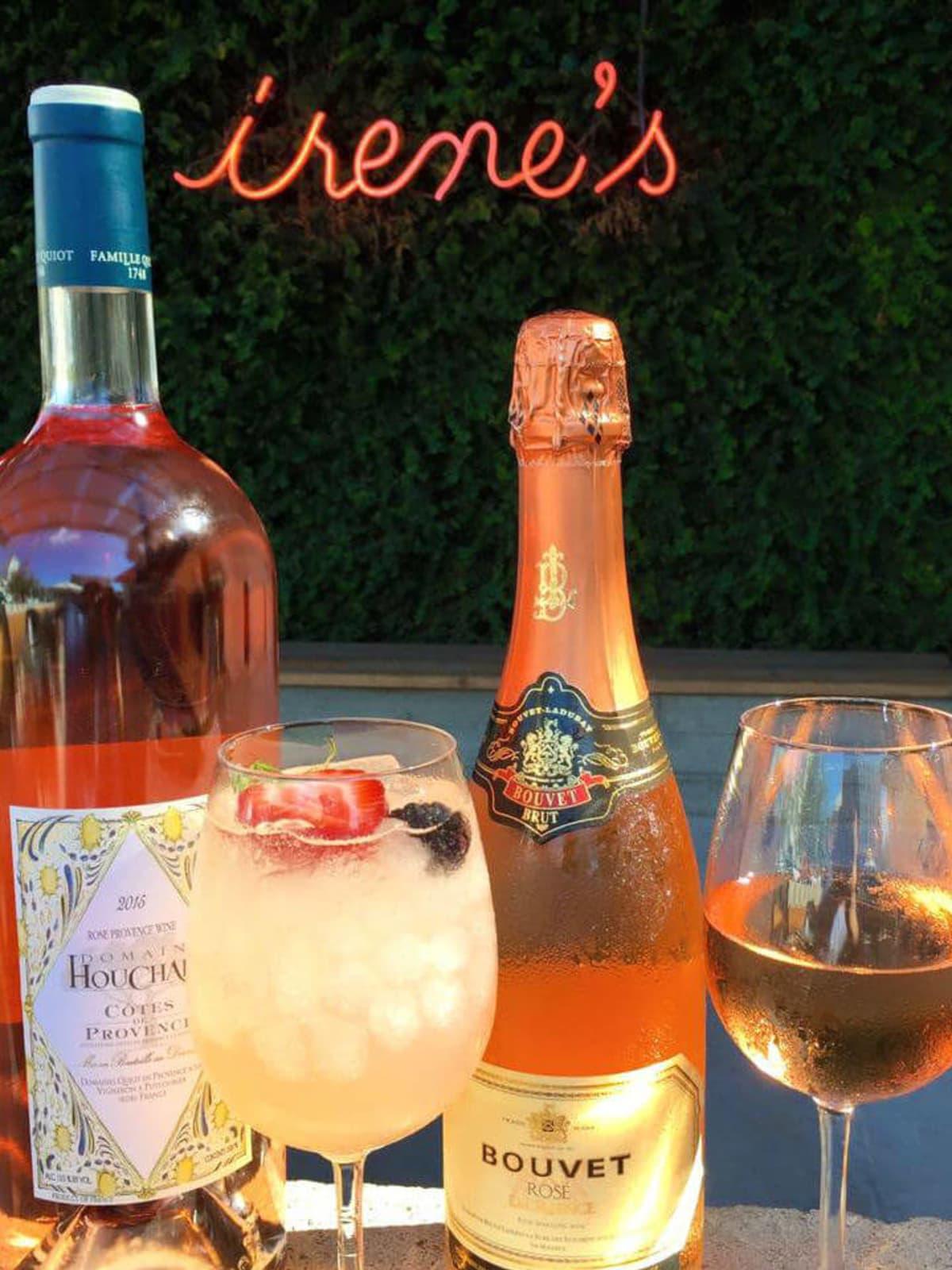 Irene's restaurant downtown Austin sign cocktail wine rose