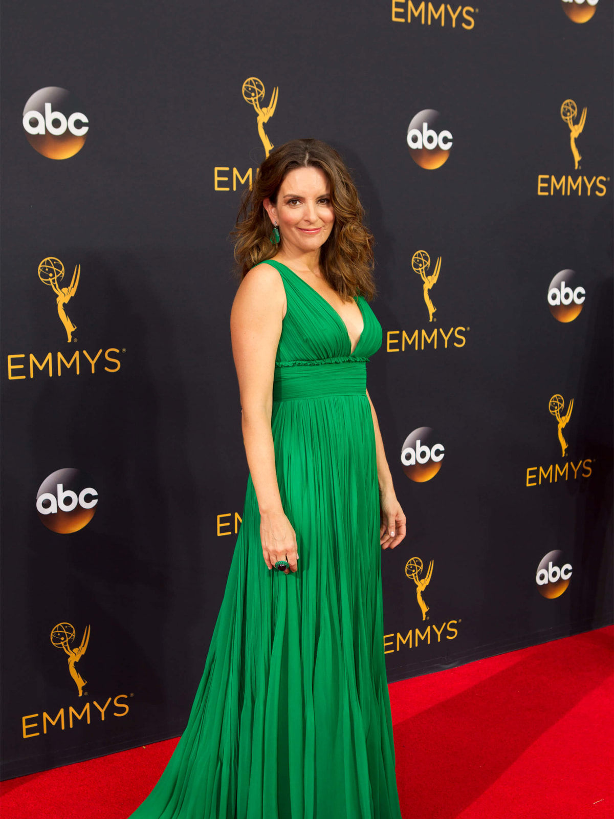 Tina Fey in green gown at Emmy Awards