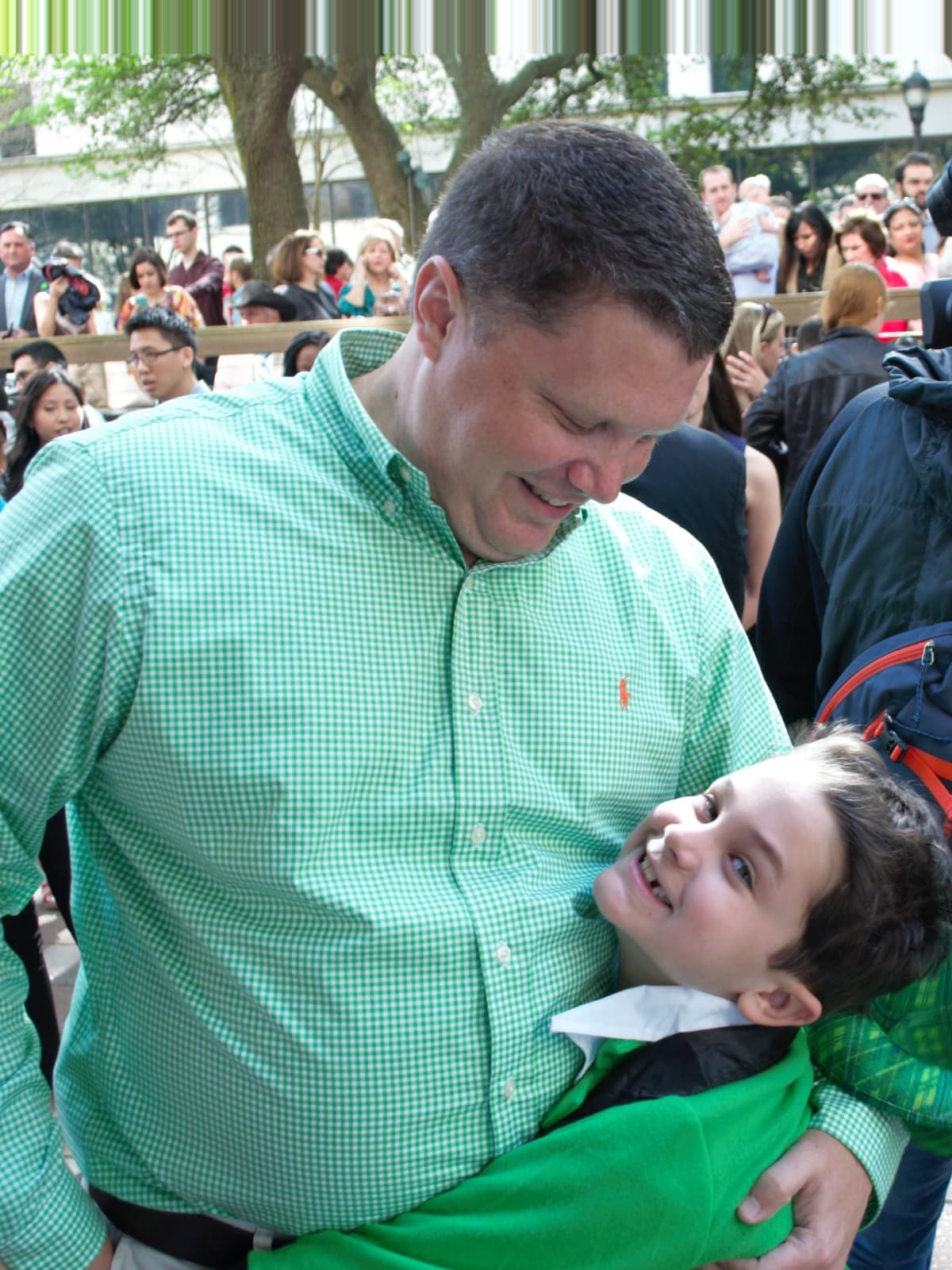 : Evan Johnson let his son Ben, 7, pick up the envelope to find out where his dad matched