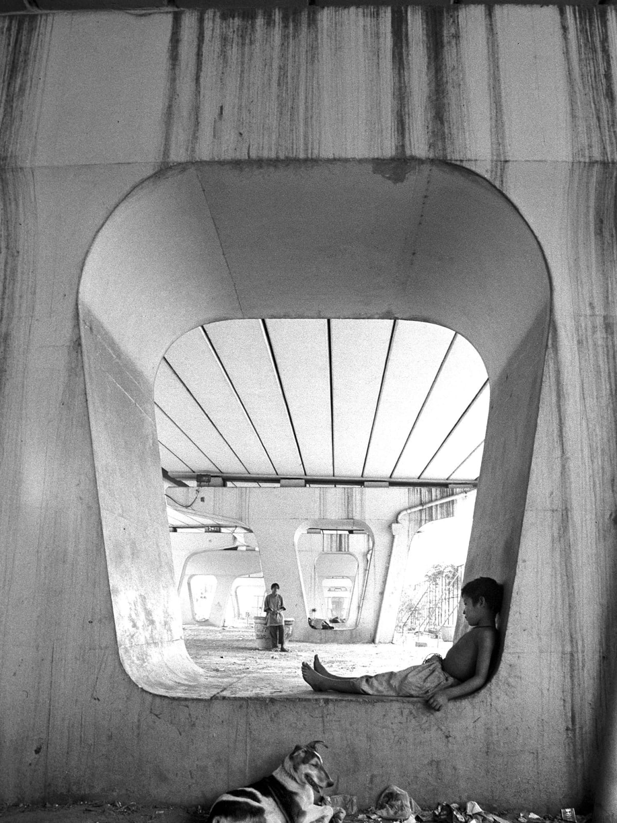 Ravi, Seven Years Old, Begging for a Living near Indian Institute of Technology Flyover, New Delhi - FotoFest