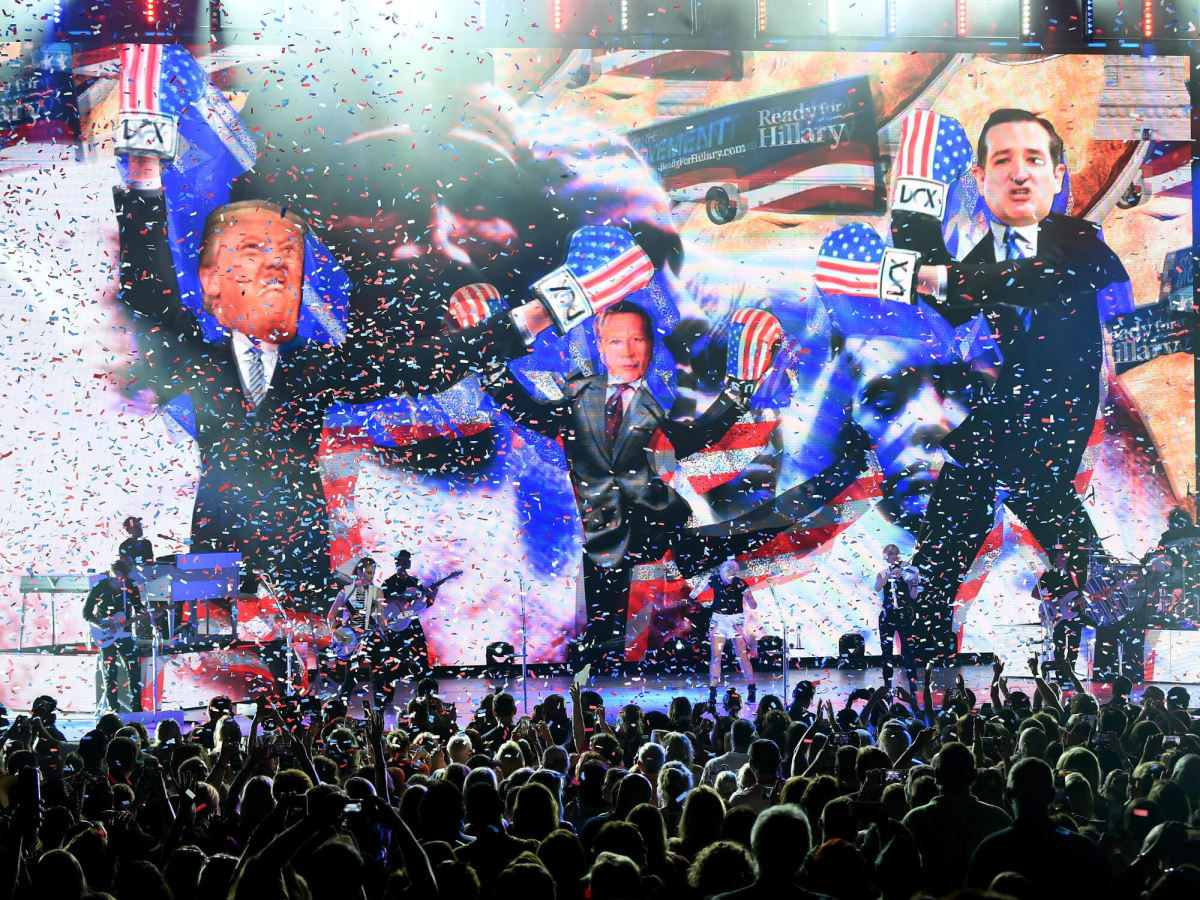 Donald Trump and Ted Cruz on screen during Dixie Chicks concert