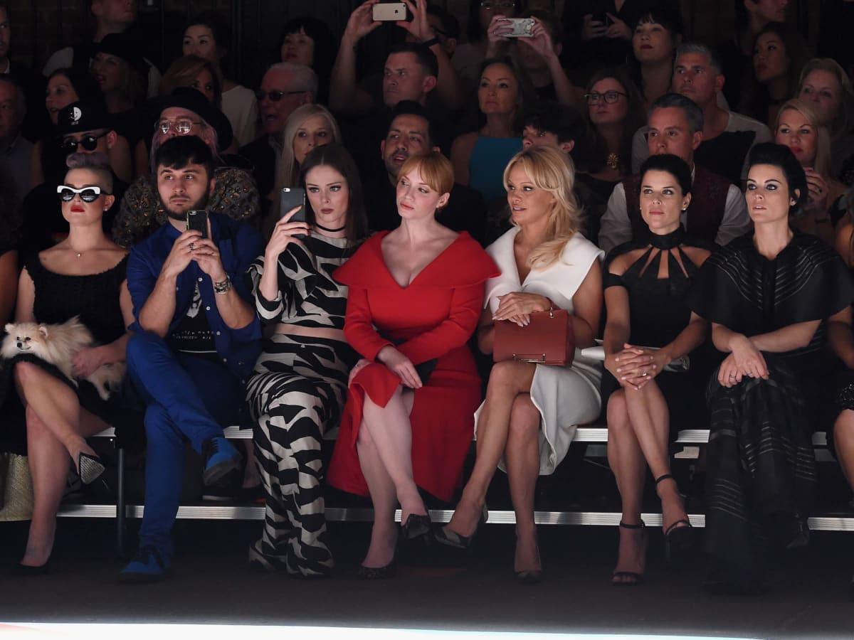 Christian Siriano front row, Kelly Osbourne with dog