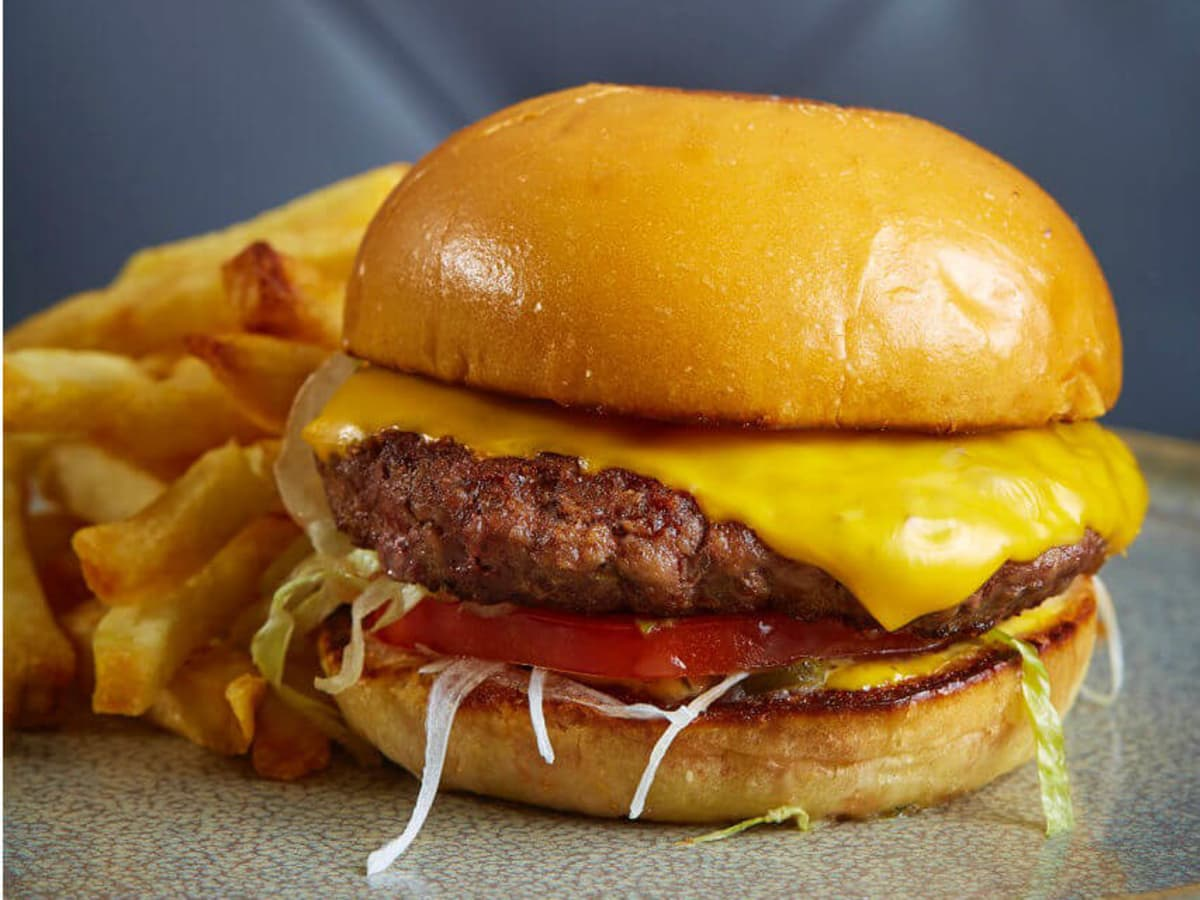 Burger with American cheese at Remedy