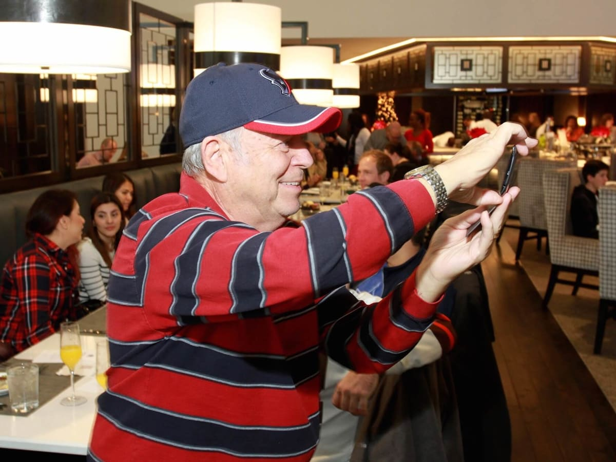Taste of NFL brunch preview, guest takes photo of chefs in action