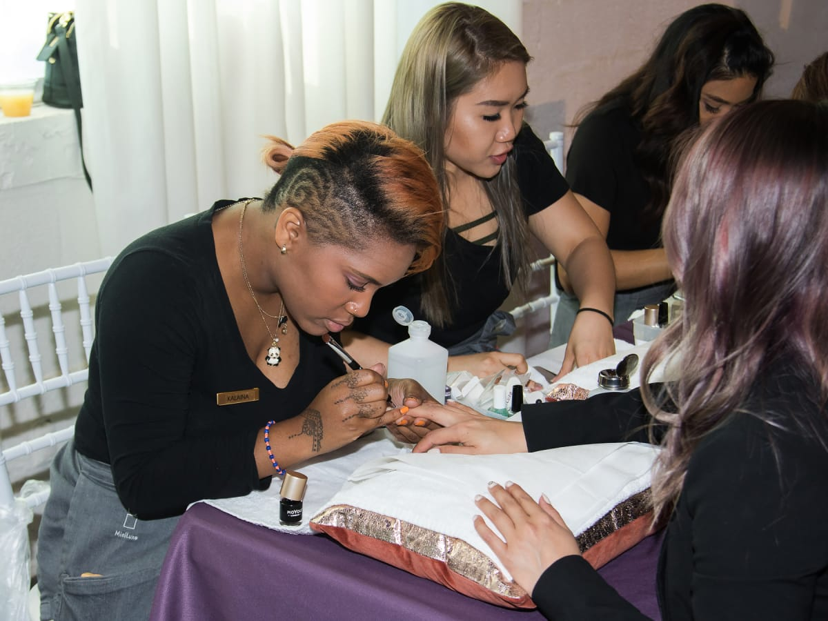 Guests getting their nails done at MiniLuxe
