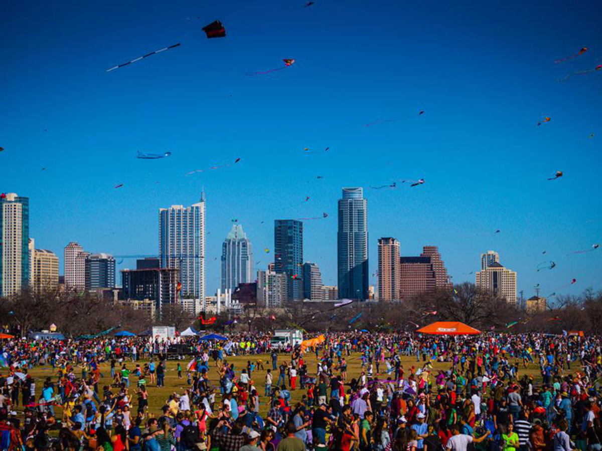Zilker Kite Festival with downtown Austin in background