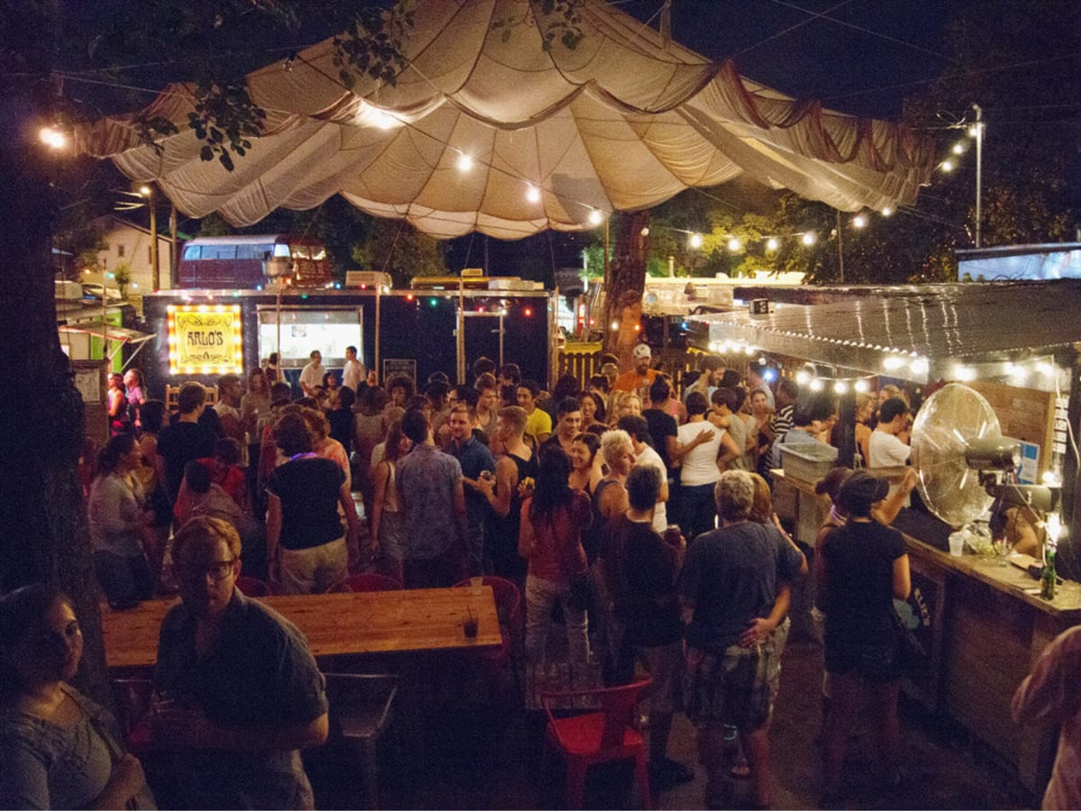 backyard exterior of Cheer Up Charlie's on east sixth with crowd