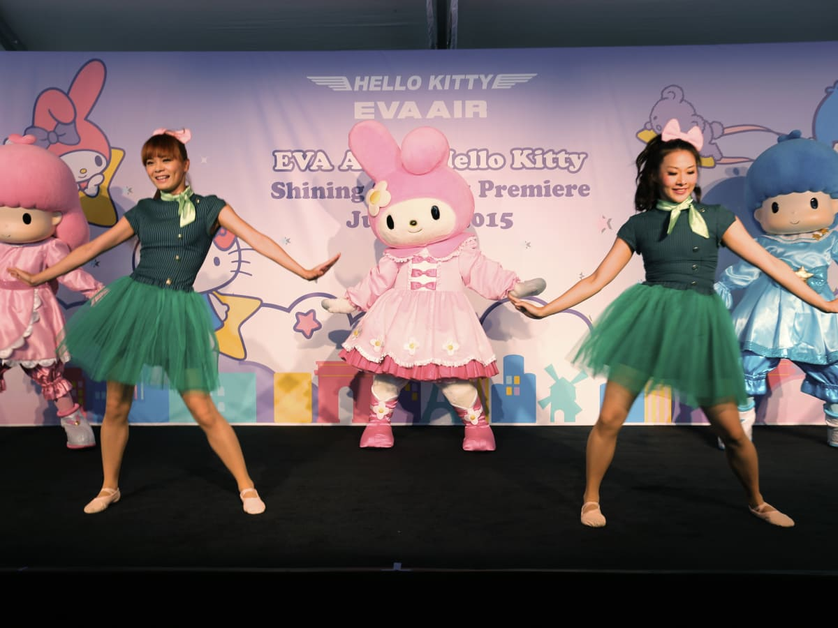 EVA Air Hello Kitty celebration characters with dancers