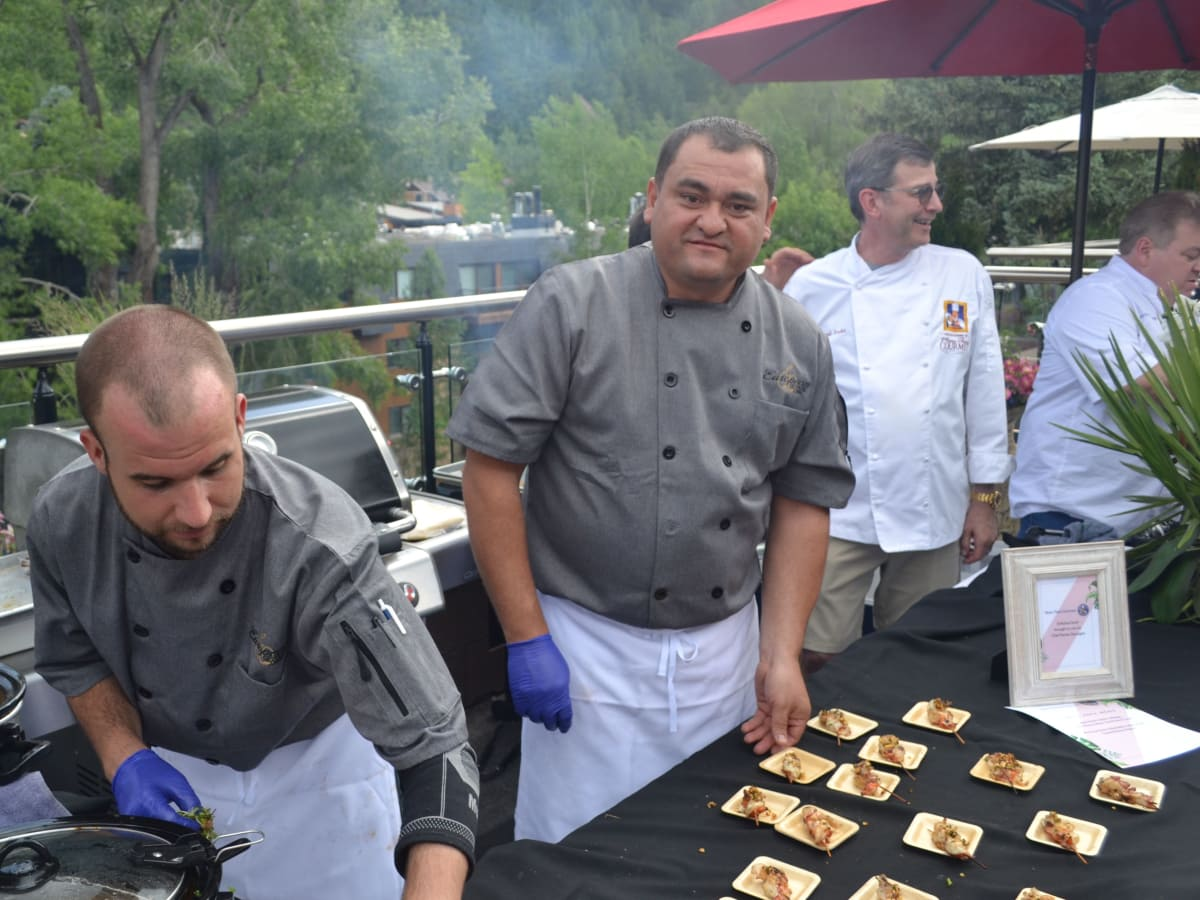 Chefs working for the large crowd at Casa Tua event at Aspen Food & Wine festival