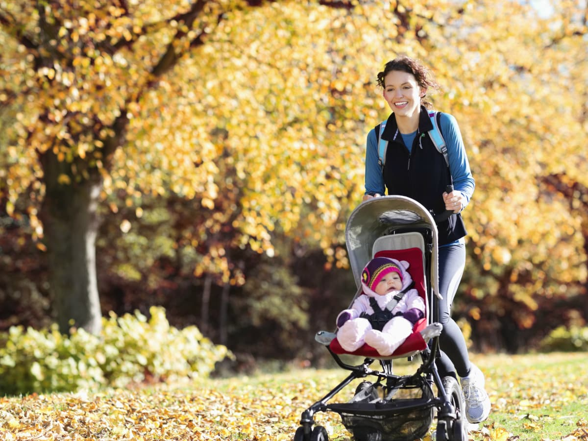 Woman jogging with baby