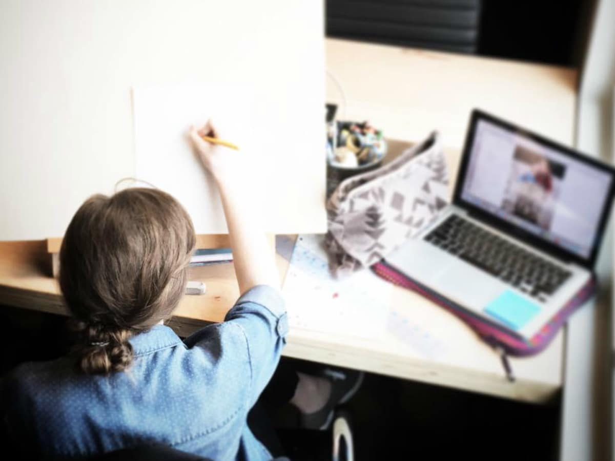 Woman working and drawing at desk with computer