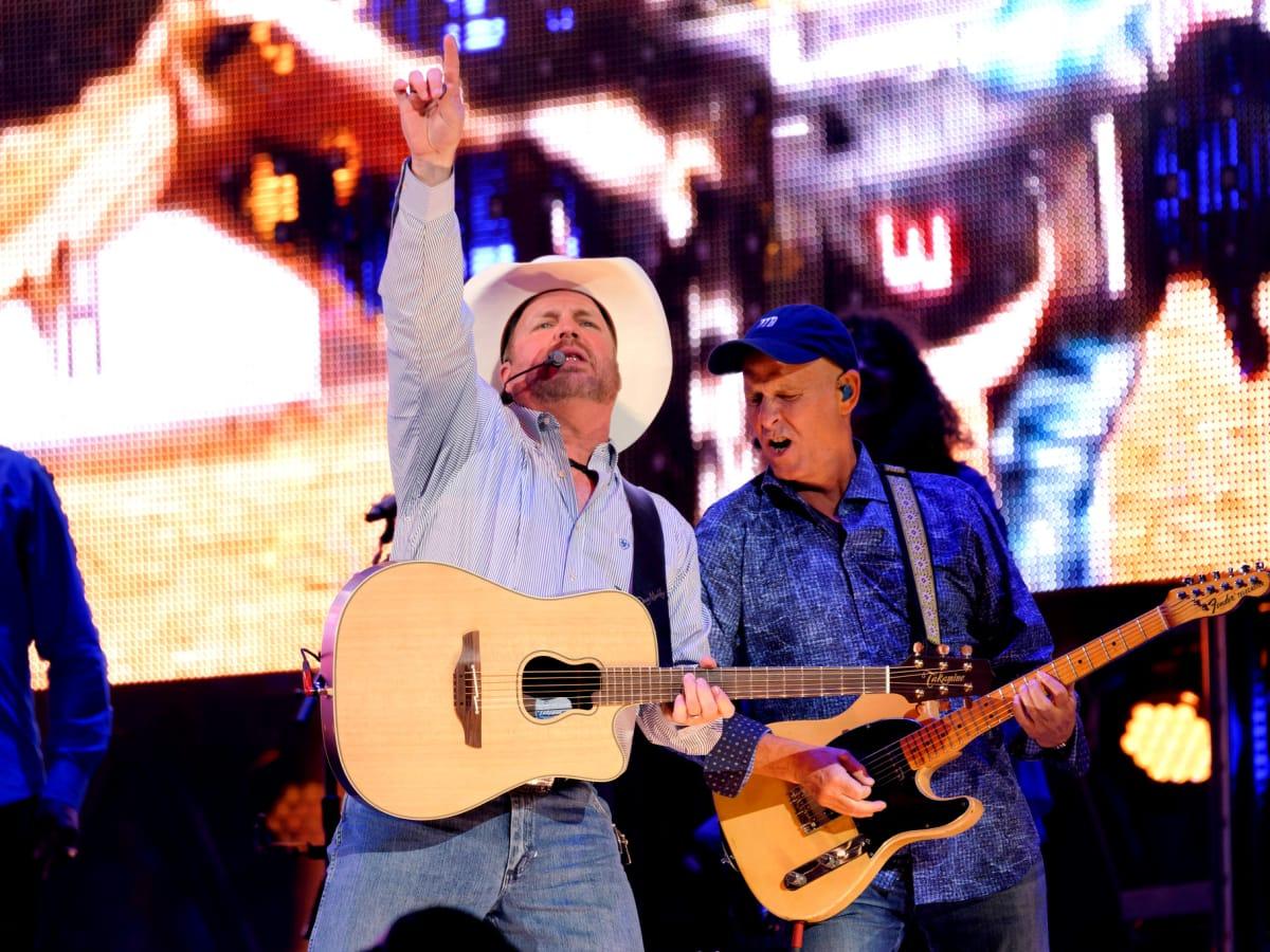 Garth Brooks opening night RodeoHouston pointing up