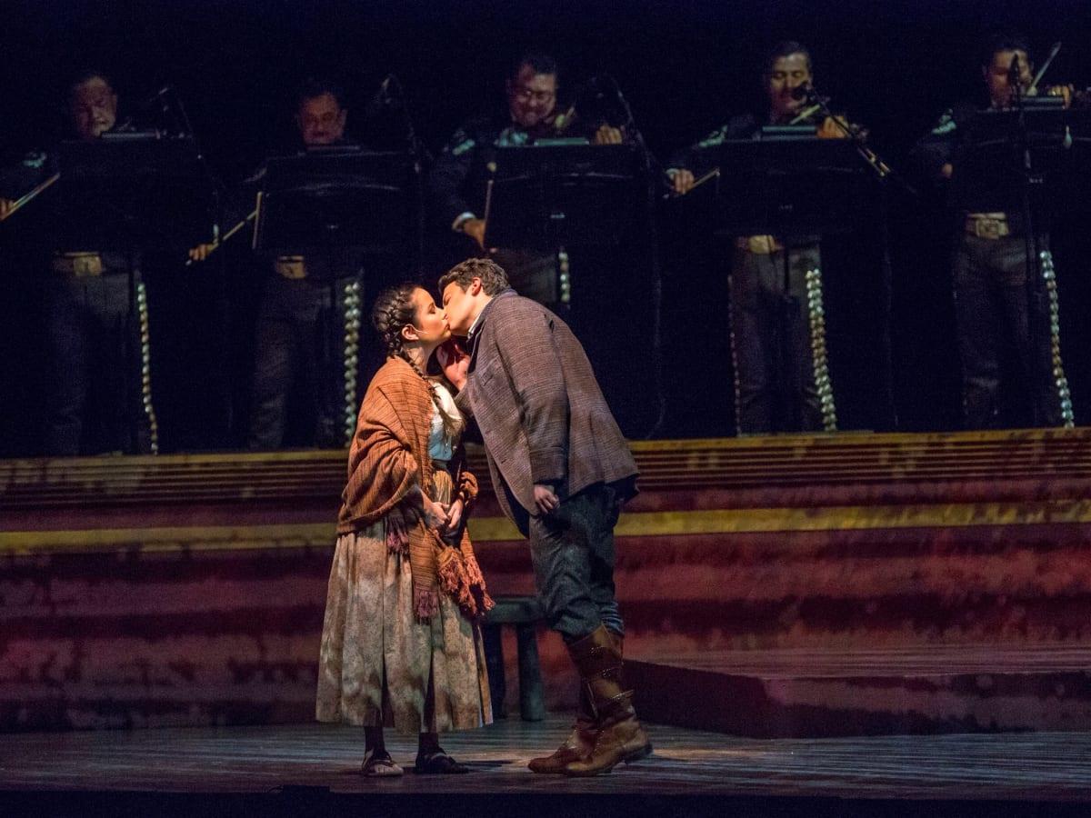 Luis (Daniel Montenegro, right) kisses Amorita (Abigail Santo Villalobos) in 'El Pasado Nunca se Termina', Fort Worth Opera