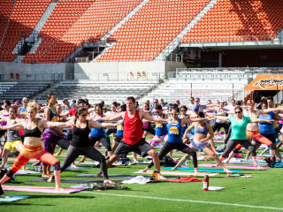yogaOne Studios and Houston Dash present Yoga on the Pitch