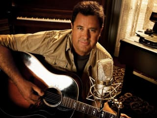 country music musician Vince Gill with a guitar