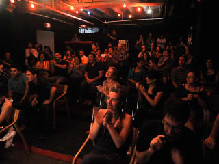 Audience at the New Movement Theater in Austin watching improv comedy