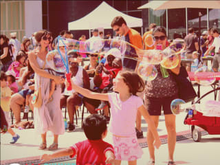 kids playing with bubbles at the Long Center's Bubblepalooza