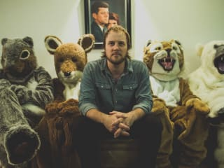 singer songwriter Chase Gassaway sitting with stuffed animals