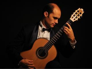 Rovshan Mamedkuliev playing guitar
