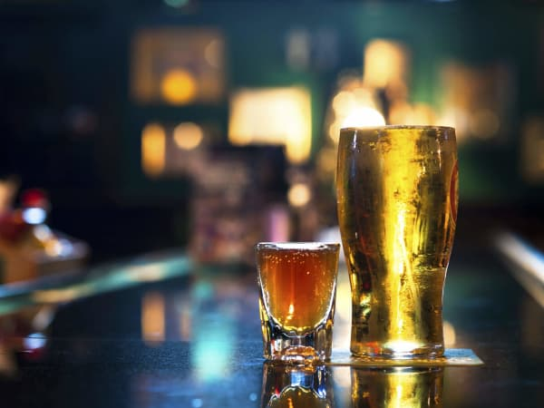 Glass of beer and a shot on a bar