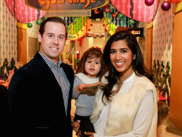 Children's Museum holiday party, Chris Brown, Divya Brown and daughter