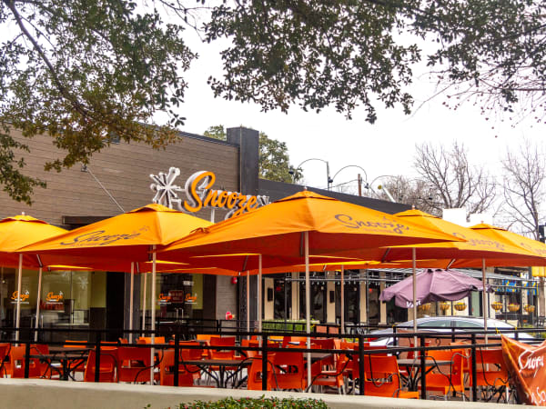 Snooze A.M. Eatery breakfast brunch restaurant Cinnful Pancakes bacoon