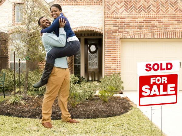 Young couple buying their first house