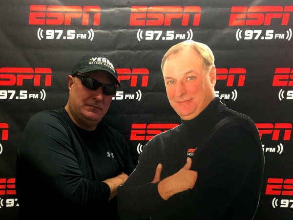 Fred Faour poses with his own cutout ESPN 97.5