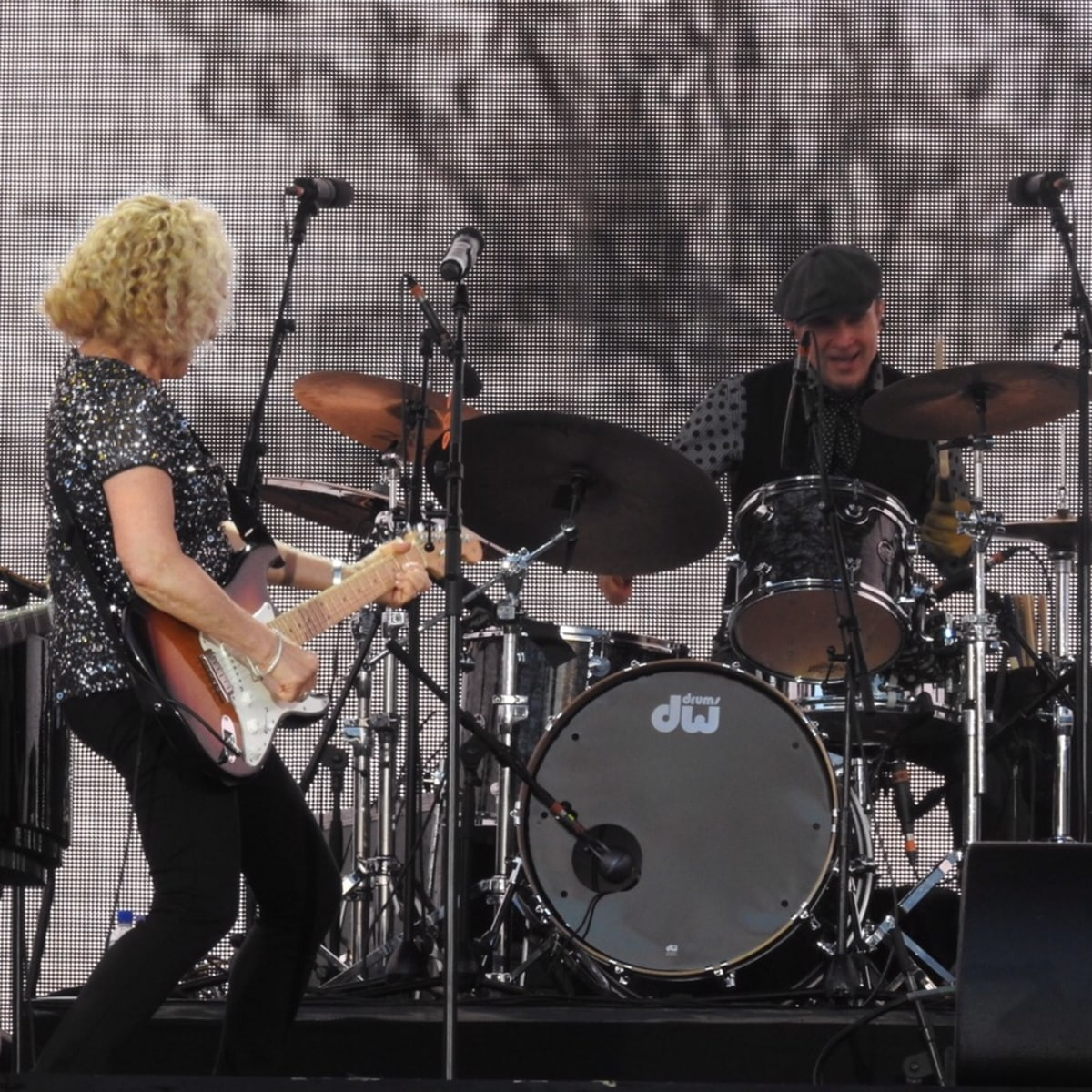 Carole King at London concert playing guitar