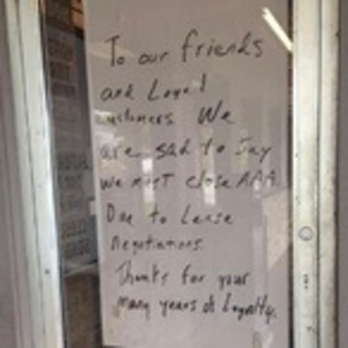 Triple A closing posted on door