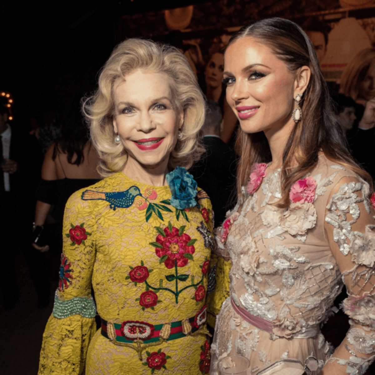 Lynn Wyatt in Gucci and Georgina Chapman at Vanity Fair party February 2016