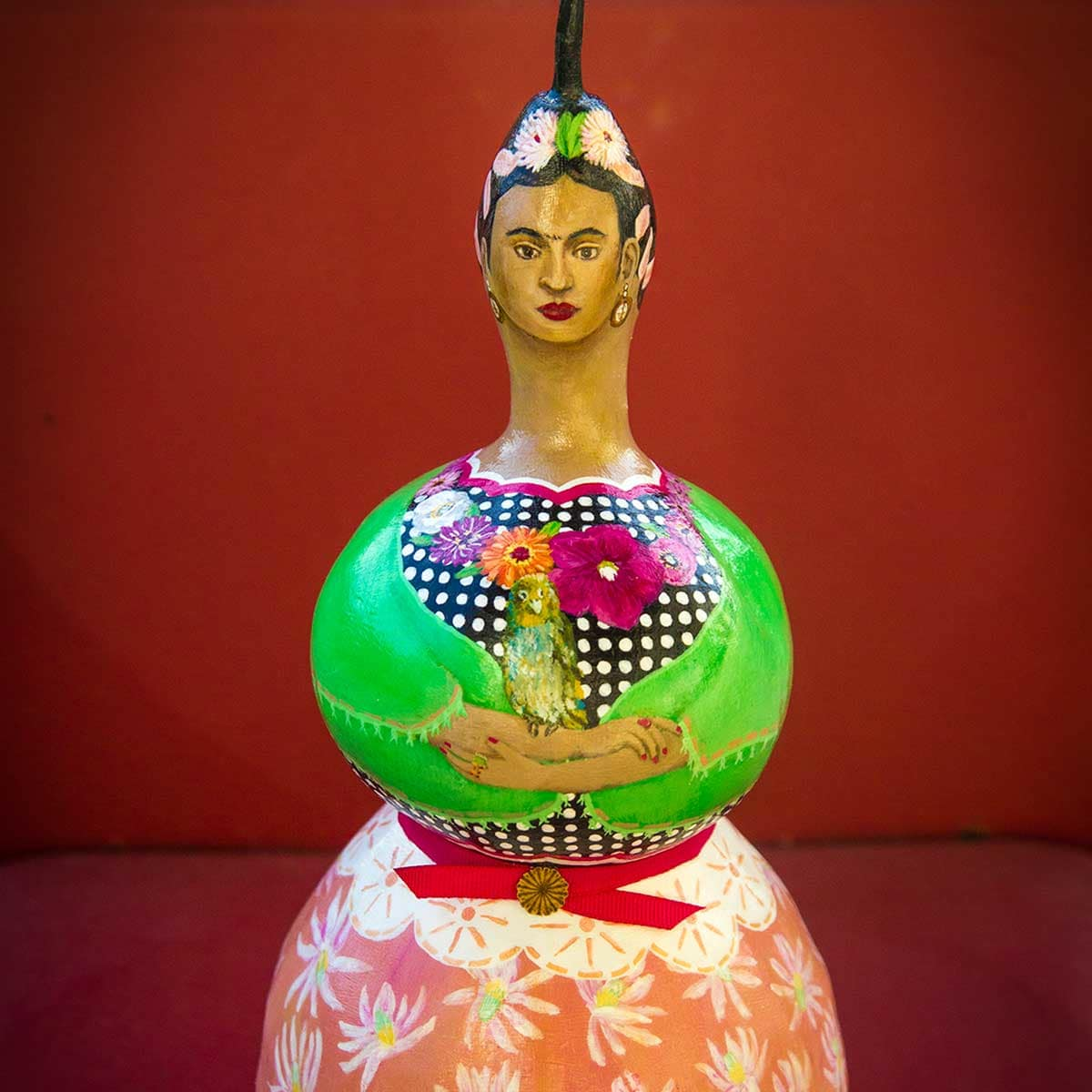Photo of painted gourd doll created by Allee Brand